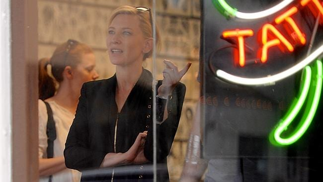 Blanchett and Adams inside the tattoo parlour. Picture: NPG.