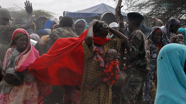 Somalia Government soldiers try to control a surging mob of Internally Displaced People who had overcrowded a feeding centre on the ouskirts of Mogadishu.Picture: AFP