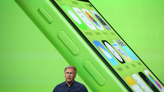 Apple Senior VP of Worldwide Marketing Phil Schiller shows off a green iPhone 5C. The new phone comes in a range of colours and will run on ioS 7. Picture: AFP