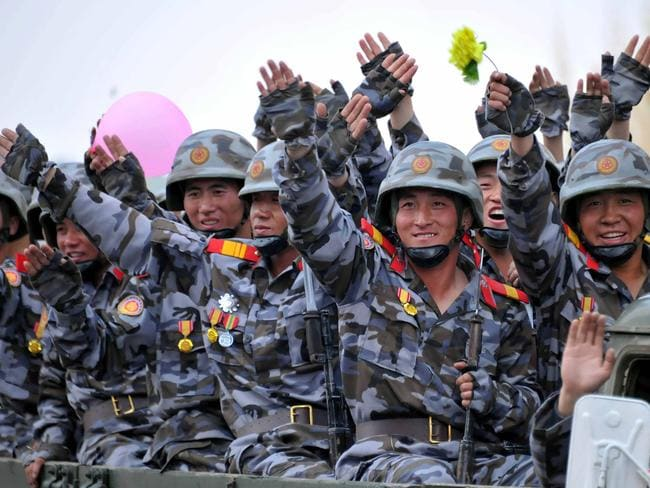 Korean People's Army personnel wave after a military parade in Pyongyang at the weekend. Picture: AFP/KCNA VIS KNS/STR