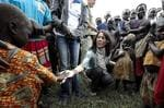 <p>Denmark's Crown Princess Mary meets with children at the Ongako IDP (Internally Displaced People) camp near Gulu in northern Uganda, Wednesday Oct. 1, 2008.</p>