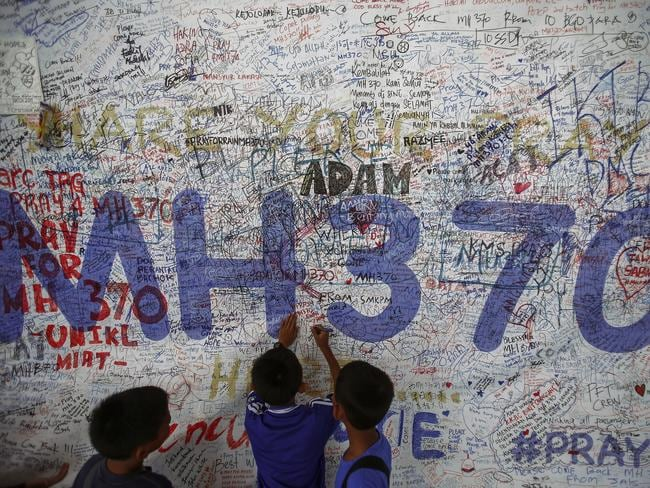 Children write messages of hope for passengers of missing Malaysia Airlines Flight MH370, which disappeared in 2014. Picture: Reuters/Samsul Said