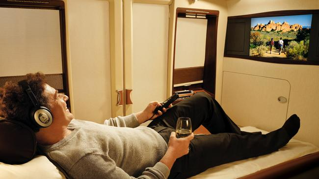 This lucky guy has plenty of room to stretch out in his first class seat on a Singapore Airlines A380 airliner.