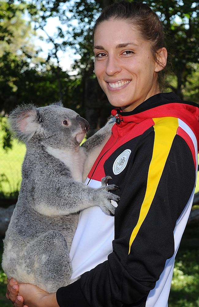 Anna Petkovic of Germany holds a koala during the official draw ahead of the Fed Cup Semi Final tie between Australia and Germany.
