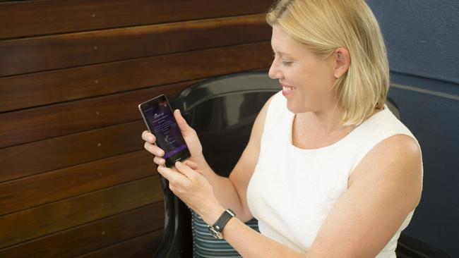 Dr Samantha Oakes of the Garvan Institute demonstrates the DreamLab smart phone app for cancer research.