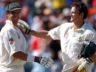 Cricketer Matthew Hayden (l) being congratulated by Adam Gilchrist after breaking the world record of 375 runs. Cricket - Australia vs Zimbabwe second day of First Test match at WACA 10 Oct 2003.