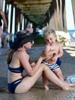 Marguerita Barone enjoys the water with her son Julian, 1, at Henley Beach. Picture: Keryn Stevens