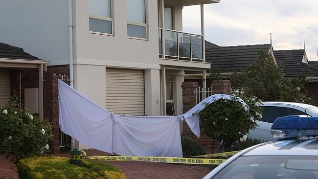 Crime-scene tape around an Encounter Bay house, where the body of a man was found. Picture Simon Cross