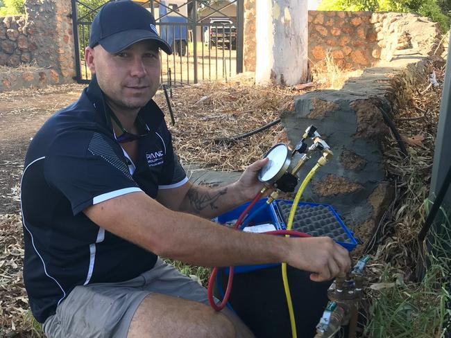Alec Sharland undertaking a backflow test on a property in Perth.