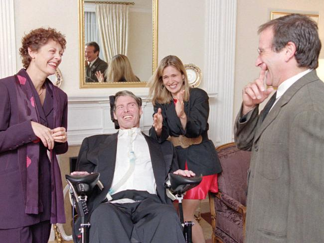 Playing for laughs ... Actor Christopher Reeve accompanied by his wife Dana, is greeted by actors Susan Sarandon, left, and Robin Williams, right, at The Creative Coalition's annual Spotlight Awards Dinner in 1995.