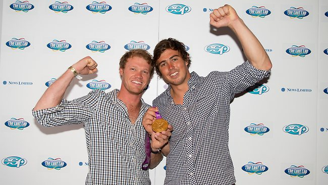 Australian sailors Nathan Outteridge and Iain Jensen with their gold medal. Picture: Dave Goudie