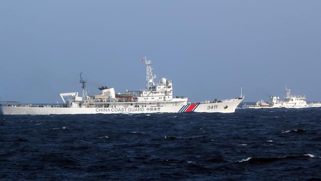Chinese coast guard vessels near the area of China's oil drilling rig in disputed waters in the South China Sea, off shore Vietnam, 14 May 2014.