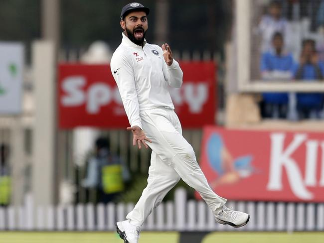 Virat Kohli celebrates another Warner dismissal. (AP Photo/Aijaz Rahi)