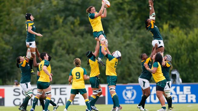 Rebecca Clough of Australia catches a lineout throw during the IRB Women's Rugby World Cup Pool C match between Australia and South Africa.