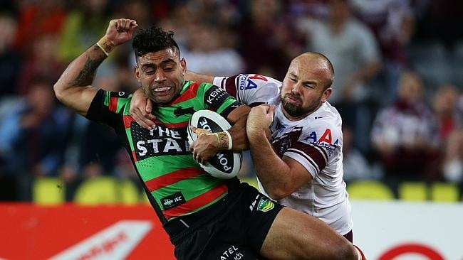 Manly's Glenn Stewart tackles South Sydney's Nathan Merritt during the NRL Preliminary Final between South Sydney and Manly at ANZ Stadium, Sydney. Pic Brett Costello