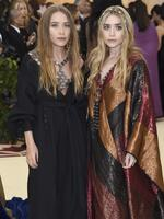 Mary-Kate Olsen, left, and Ashley Olsen attend the Heavenly Bodies: Fashion and The Catholic Imagination Costume Institute Gala at The Metropolitan Museum of Art on May 7, 2018 in New York City. Picture: AP