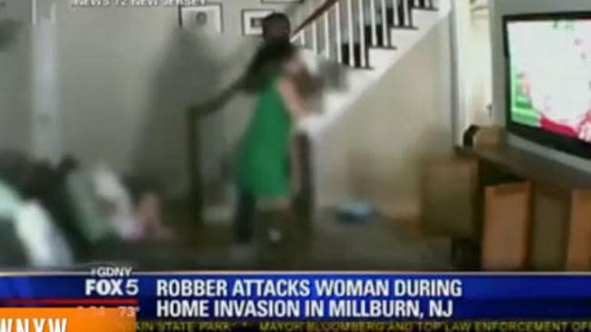 The frightening moment a woman was violently attacked during a home invasion. Picture: Screengrab