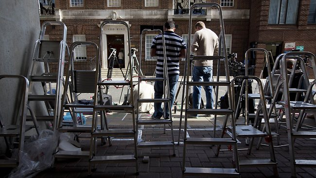 Members of the media start to set up their ladders and tripods outside The Lindo Wing of Saint Mary's Hospital in Paddington, west London on July 1, 2013. Prince William and his wife Catherine's baby, which will be third in line to the throne, will be born in the private Lindo wing of St Mary's Hospital, where William was born in 1982 and his brother Harry in 1984. AFP PHOTO / JUSTIN TALLIS