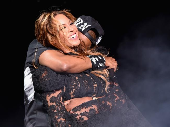 What marriage woes? ... Jay Z gives wife Beyonce a hug as they perform onstage during their On The Run Tour in Chicago, Illinois. Picture: Supplied