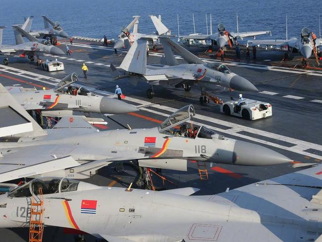 Fighter jets crowd the deck of the aircraft carrier, Liaoning. China's first home-built design is based on this Soviet-built ship. Picture: Xinhua