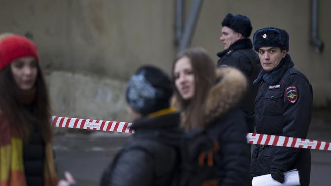 Russian news agencies report that police have arrested a woman who was waving the severed head of a small child outside a Moscow subway station. Picture: Alexander Zemlianichenko