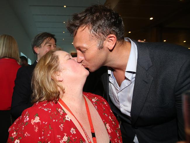 Magda Szubanski and Ian Thorpe share a kiss after the Same Sex Marriage Bill passes in the House of Representatives Chamber, at Parliament House in Canberra.