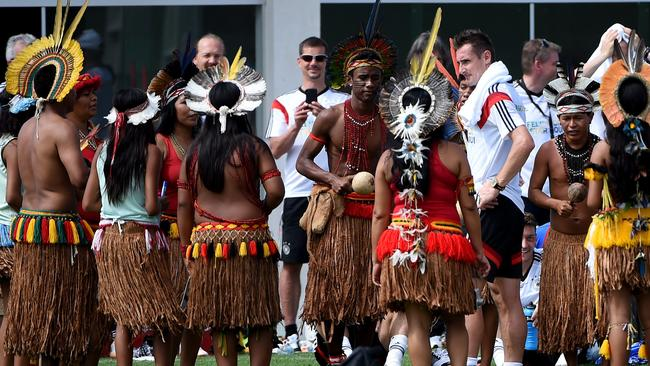 Germany's forward Miroslav Klose (R) dances at his birthday with Brazilian natives.