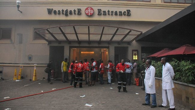 Rescue team members wait at the entrance of the Westgate Mall ready to assist freed hostages. Picture: AFP