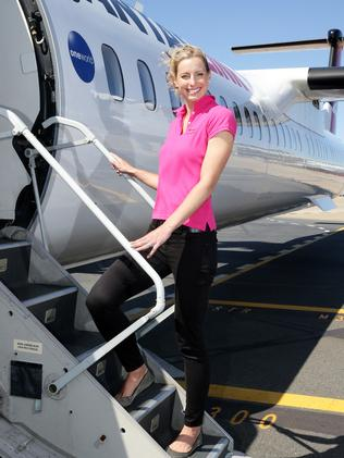 Laura Geitz, Brisbane West Wellcamp Airport ambassador, with one of the planes that will be used for the first flights from the new airport. Photographer: Liam Kidston