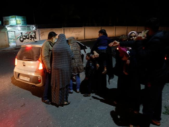 Palestinians leave their houses following an Israeli air strike in Beit Lahia. Picture: AFP