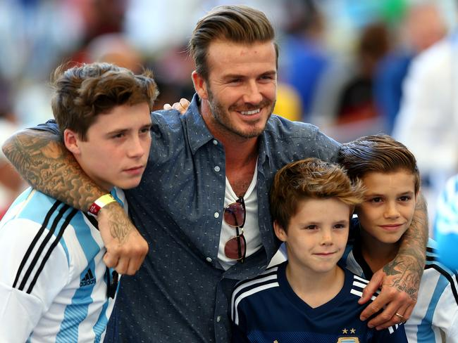 Former England international David Beckham and sons Brooklyn Beckham (L), Cruz Beckham (2nd R) and Romeo Beckham (R) prior to the 2014 FIFA World Cup Brazil final.