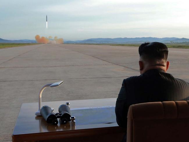Kim Jong-un inspecting a launching drill of the medium-and-long range strategic ballistic rocket Hwasong-12. Picture: AFP