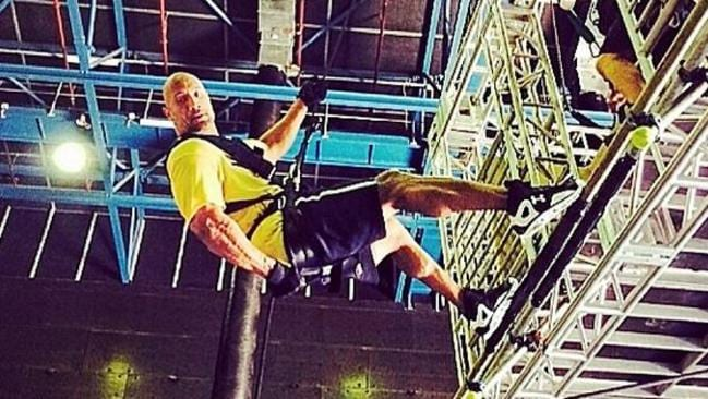 Action man ... Dwayne Johnson, aka The Rock, rappells during a stunt on the set of San Andreas on the Gold Coast. Picture: Instagram