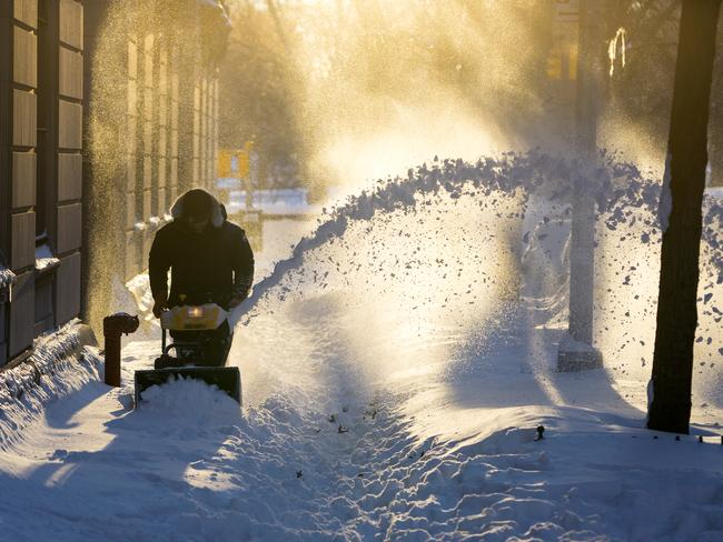 Making way ... snow is cleared along a street in the Upper West Side neighbourhood of New York City. Picture: AP Photo/Craig Ruttle
