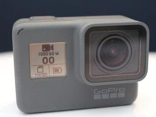 A picture taken on September 28, 2017 shows the new-generation Hero 6 mini-camera released by GoPro at a media event in San Francisco. GoPro on Thursday beefed up its line of action-catching mini-cameras as the struggling company aimed to ride the growing wave of creating captivating video to share online. A new Hero 6 priced at $499 was billed as the most powerful and easy-to-use GoPro model to date, capable of capturing video in ultra-high definition 4K resolution. / AFP PHOTO / Glenn CHAPMAN