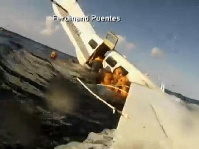 Passengers hang on for their lives. Picture: Ferdinand Puentes