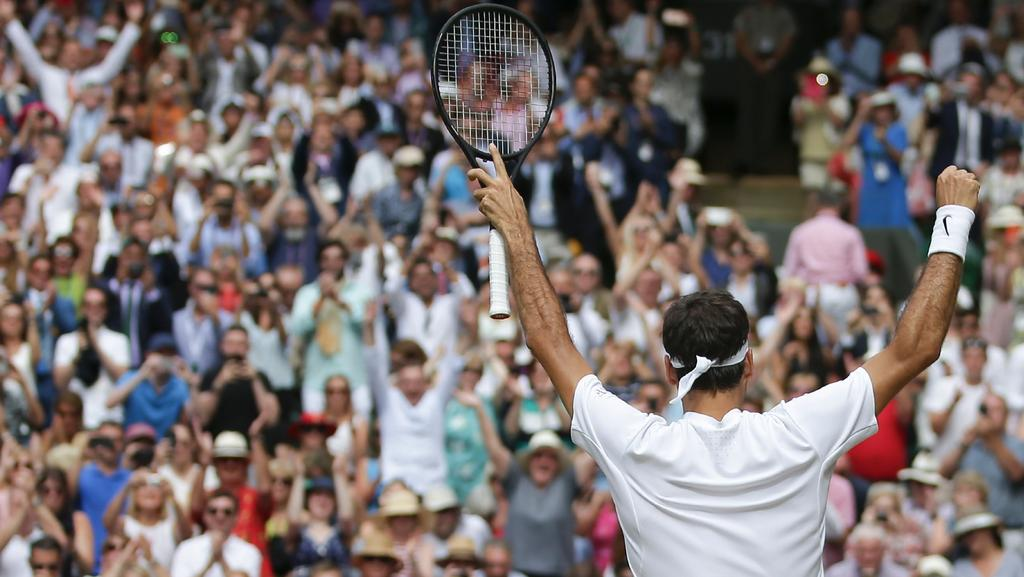 The crowd rise to acclaim the new Wimbledon champion.