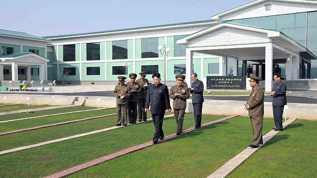 "This undated picture released from North Korea's official Korean Central News Agency (KCNA) on May 6, 2013 shows North Korean leader Kim Jong-Un (C) inspecting the newly built Turf Institute of the Bioengineering Branch under the State Academy of Sciences in suburban Pyongyang. AFP PHOTO / KCNA via KNS THIS PICTURE WAS MADE AVAIALBLE BY A THIRD PARTY. AFP CAN NOT INDEPENDENTLY VERIFY THE AUTHENTICITY, LOCATION, DATE AND CONTENT OF THIS IMAGE. THIS PHOTO IS DISTRIBUTED EXACTLY AS RECEIVED BY AFP. ---EDITORS NOTE--- RESTRICTED TO EDITORIAL USE - MANDATORY CREDIT ""AFP PHOTO / KCNA VIA KNS"" - NO MARKETING NO ADVERTISING CAMPAIGNS - DISTRIBUTED AS A SERVICE TO CLIENTS"