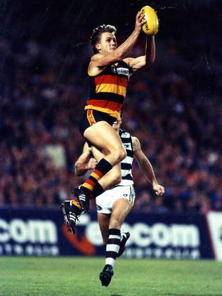 Tony Modra pulls in a strong mark in 1993