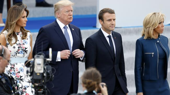 USPresident Donald Trump and his wife Melania Trump, French President Emmanuel Macron and his wife Brigitte attend the traditional Bastille day military parade on the Champs Elysees. Picture: Thierry Chesnot/Getty Images.