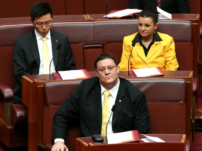 Getting down to business ... Palmer United Party Senators Dio Wang, Jacqui Lambie and Glenn Lazarus on their first day in the Senate yesterday. Picture: Kym Smith