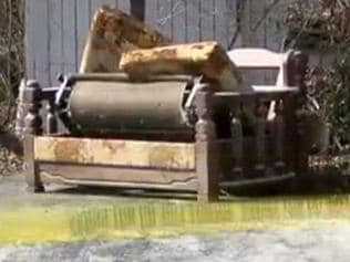 Barbara Foster was found moulded to her chair. (Sofabed pictured outside her home.). Picture: WKRN