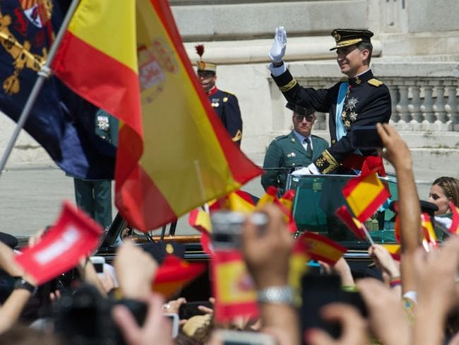 Celebrations ... Spaniards wave flags after King Felipe VI's coronation. Picture: Getty