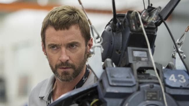 (L-R)— Hugh Jackman, Hugh Jackman's semi-mullet, Chappie the cop-bot in Chappie.