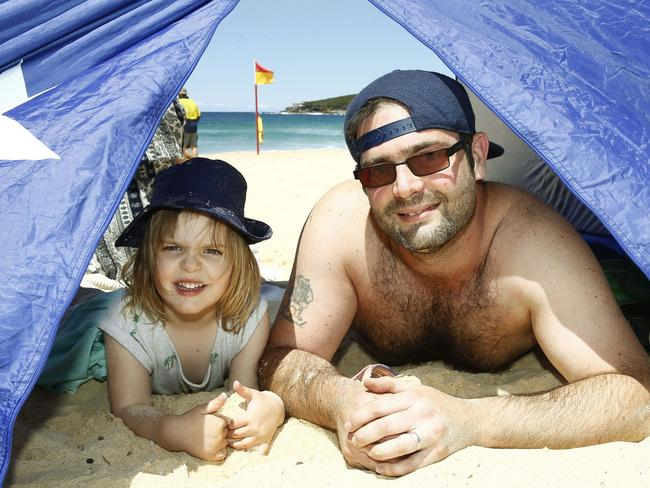 Scarlett Williams, 3, and her dad Paul Williams play it sun-safe at Maroubra Beach. Picture: John Appleyard