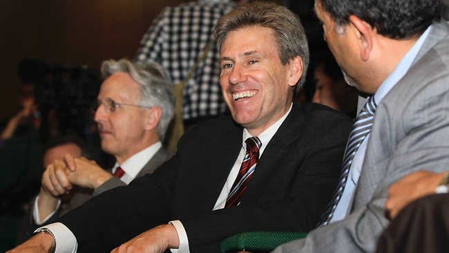 In this photo taken Monday, April 11, 2011, then U.S. envoy Chris Stevens, center, accompanied by British envoy Christopher Prentice, left, speaks to Council member for Misrata Dr. Suleiman Fortia, right, at the Tibesty Hotel where an African Union delegation was meeting with opposition leaders in Benghazi, Libya. Libyan officials say the U.S. ambassador and three other Americans have been killed in an attack on the U.S. consulate in the eastern city of Benghazi by protesters angry over a film that ridiculed Islam's Prophet Muhammad. (AP Photo/Ben Curtis)