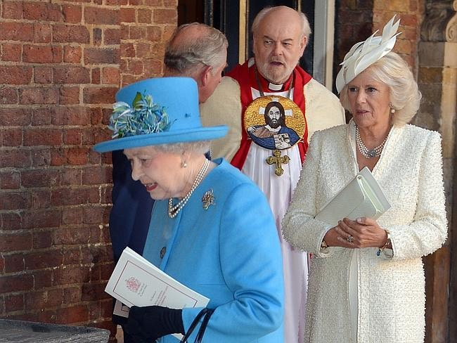 Queen Elizabeth II followed by Prince Charles, Prince of Wales and Camilla, Duchess of Cornwall leave the Chapel Royal following the christening with Archbishop of Canterbury, Justin Welby in St James's Palace, ahead of the christening of the three month-old Prince George of Cambridge. Picture: Getty