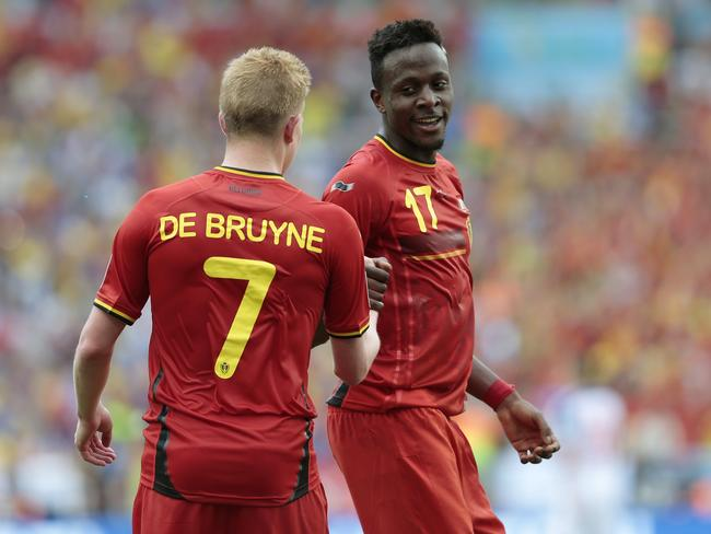 Belgium's Divock Origi, right, celebrates with Kevin De Bruyne after scoring the winner against Russia.