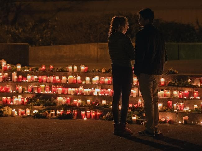 Mourning ... students from the Joseph-Koenig Gymnasium in Haltern, western Germany, stand at a makeshift memorial. Students of this school were among the victims of the Germanwings plane crash. Picture: AP Photo/Martin Meissner,