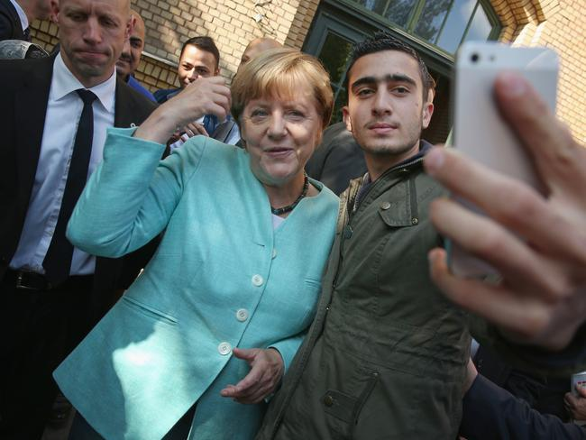 German Chancellor Angela Merkel poses for a selfie with Anas Modamani, a refugee from Syria. Modamani is suing Facebook for failing to remove fake postings linking him to terror organisations, thereby breaking German law. Picture: Getty